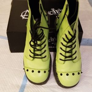 Green ankle boots with spikes.